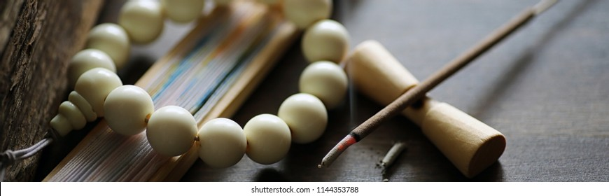 Different objects with traditional religious oriental on a wooden background