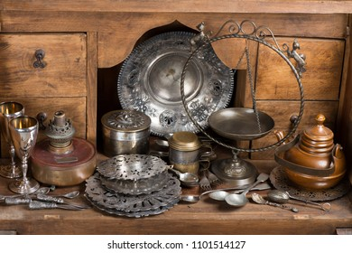 Different old things on a rustic wooden sideboard.