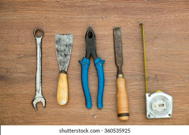 different old tools on wood