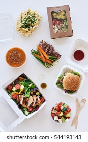 Different options variety assortment of takeout food gourmet takeaways