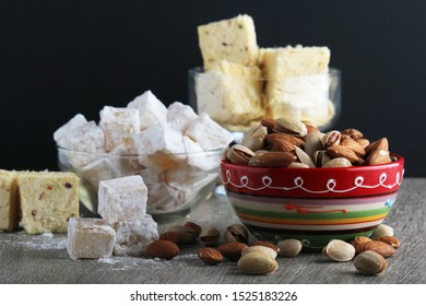 Different oriental sweets: turkish delight, halva, almond and pistachio
