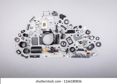 Different parts with a photo camera on a gray background. Repair service concept