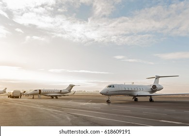 Different passenger aircrafts situating at runway