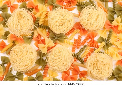 A different pasta in three colors close-up on the white background.