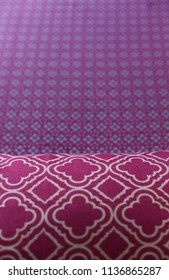 Different patterns in pink and magenta on textiles.