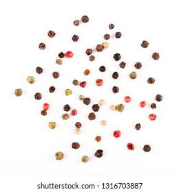 Different pepper mix isolated on white background. Black, red and white peppercorns macro closeup top view