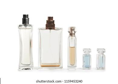Different perfume bottles on white background
