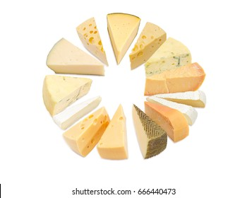 Different pieces of hard cheese, semi-soft cheese and soft cheese various types lined up in a circle on a light background