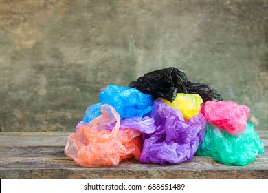 Different plastic bags on wooden background.