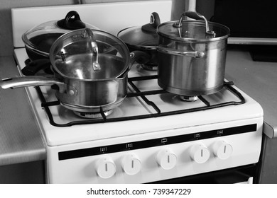 Different plates are on the surface of the gas stove in the kitchen