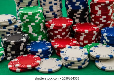 Different poker chips on table at casino