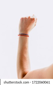 Different postures of hands with a bracelet with the flag LGBT  on a yellow and white background.