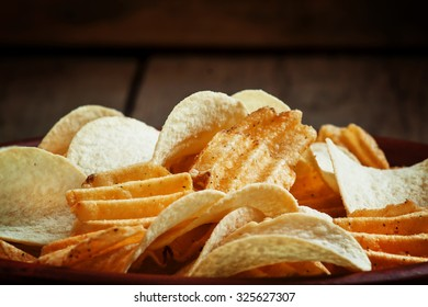 Different potato chips on a plate, beer snack, selective focus