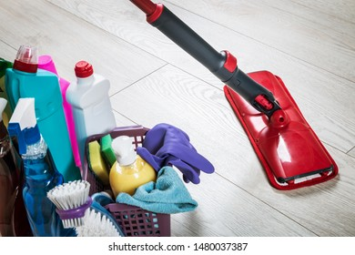 different products and items for cleaning on the floor in the room. Concept cleaning