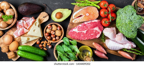 Different products for ketogenic diet on a dark concrete background