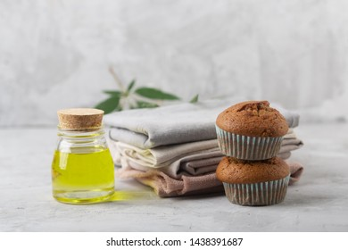 Different products from marijuana. Baking muffins from cannabis, natural CDB fabric and oil. Gray background