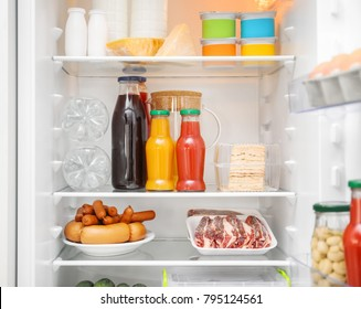 Different products on refrigerator shelves