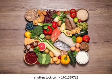 Different products on wooden table, top view. Healthy food and balanced diet
