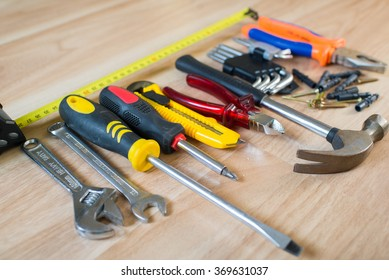 Different repair instruments on the wooden table. Used instruments