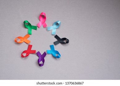 Different ribbons, symbols of cancer, cancer awareness month.  Copy space for your text.