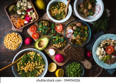 Different salad and snack on the wooden table top view