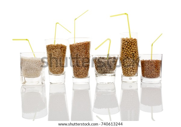 Different seeds and grains for healthy vegan milk -  rice, soya, oat, hemp, buckwheat and wheat in glasses isolated on white background.