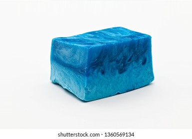 Different shades of blue natural soap bar piece on white limbo background