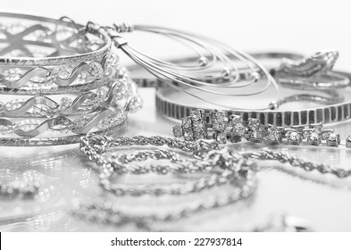 Different silver jewelry on the table.