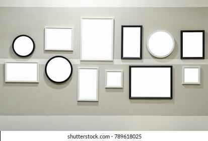 Different size of black and white photo frame on wall