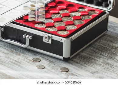 Different size collector's coins in the box, soft focus background