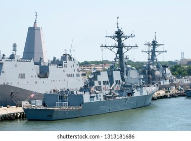 Different size navy ships in a military base outside Norfolk (West Virginia).