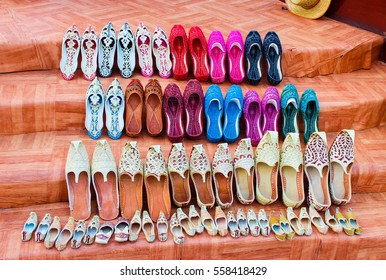 Different size traditional Arabic Shoes - multicolored, decorated with sequins, slippers or khussa jutti or babouches