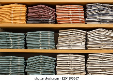 Different sizes of clothes in the shop. Close up