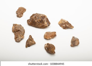Different sizes of flintstones on a white background