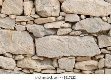 Different sizes of stones make up the pattern for this stone wall