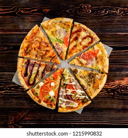 Different slices of pizza laid out in the shape of a round pizza on a wooden background