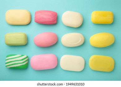 Different soaps in different soap dishes. A lot of solid soap for hygiene and cleanliness. Colorful soap and remnants are scattered on mine background.