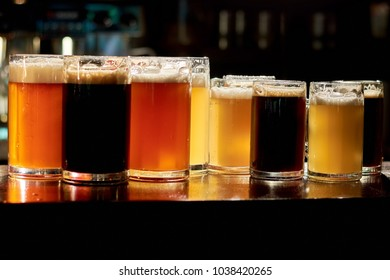 Different sorts of beer in bar. Variety of different sorts of beers in pub. Assorted drinks for tasting.