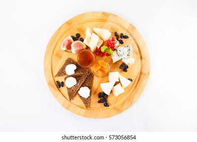 different sorts cheese wooden plate