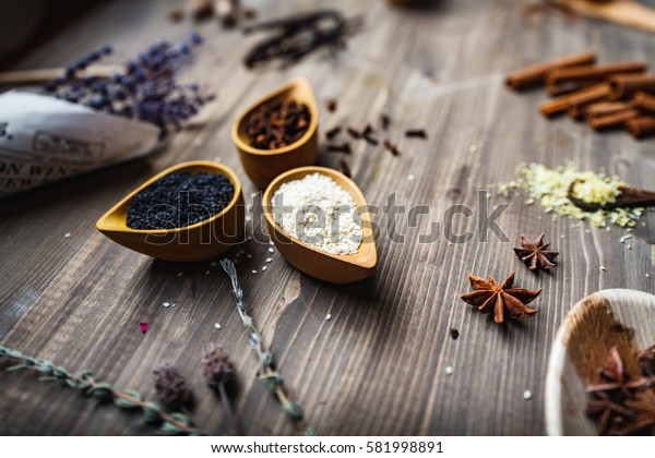 Different spices, herbs and roots view from the top. On rustic background. tilt shift effect