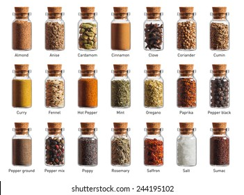 different spices in a little bottles isolated on white background