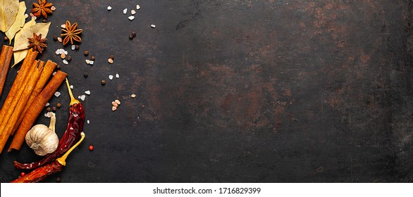 Different spices on textured background with place for copy