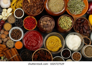 different spices on wooden background. top view