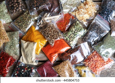 Different spices in plastic zipper bags, top view