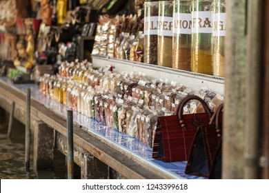 a lot of different spices for sale on a stall of the famous damnoen saduak floating market in Ratchaburi, Thailand