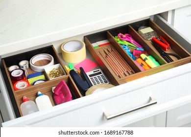 Different stationery in open desk drawer indoors