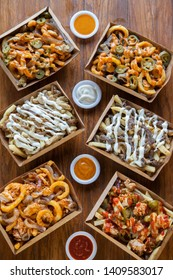 Different style french fries poutine with ranch sriracha mayo cheese flavours
