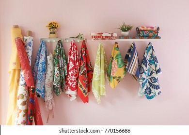 different style hanging scarf on the pink wall stle