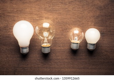 Different style and size of light bulbs in comparison concept