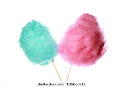 Different tasty cotton candies on white background